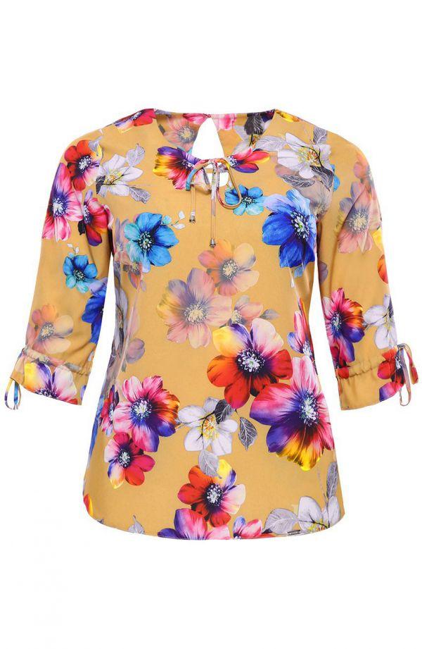 Musztardowa bluzka w kolorowe kwiaty